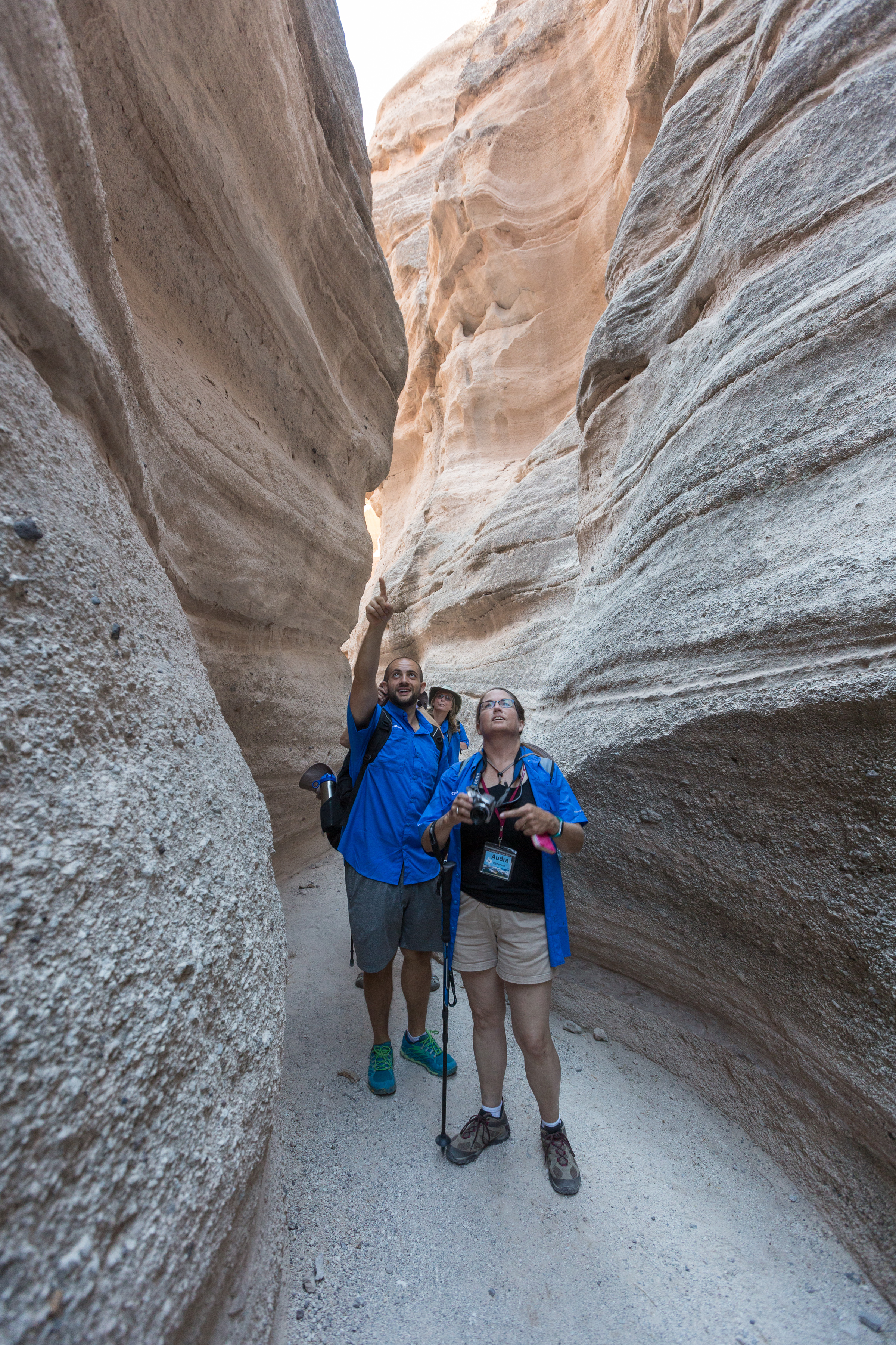 Two participants in the G-Camp explore a slot canyon in New Mexico's Kasha-Katuwe Tent Rocks National Monument. (Source: Aramco Services Co.)
