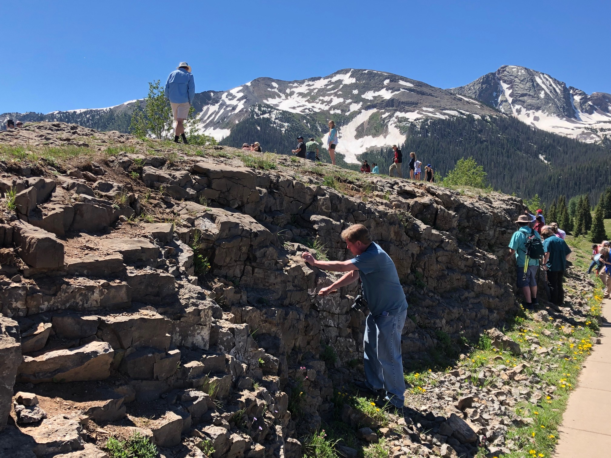 At a stop at the Molas Pass in Durango, Colo., a glacial valley in the San Juan Mountain, educators carved fossils from the surrounding landscape. (Photo by Brian Walzel, Hart Energy)