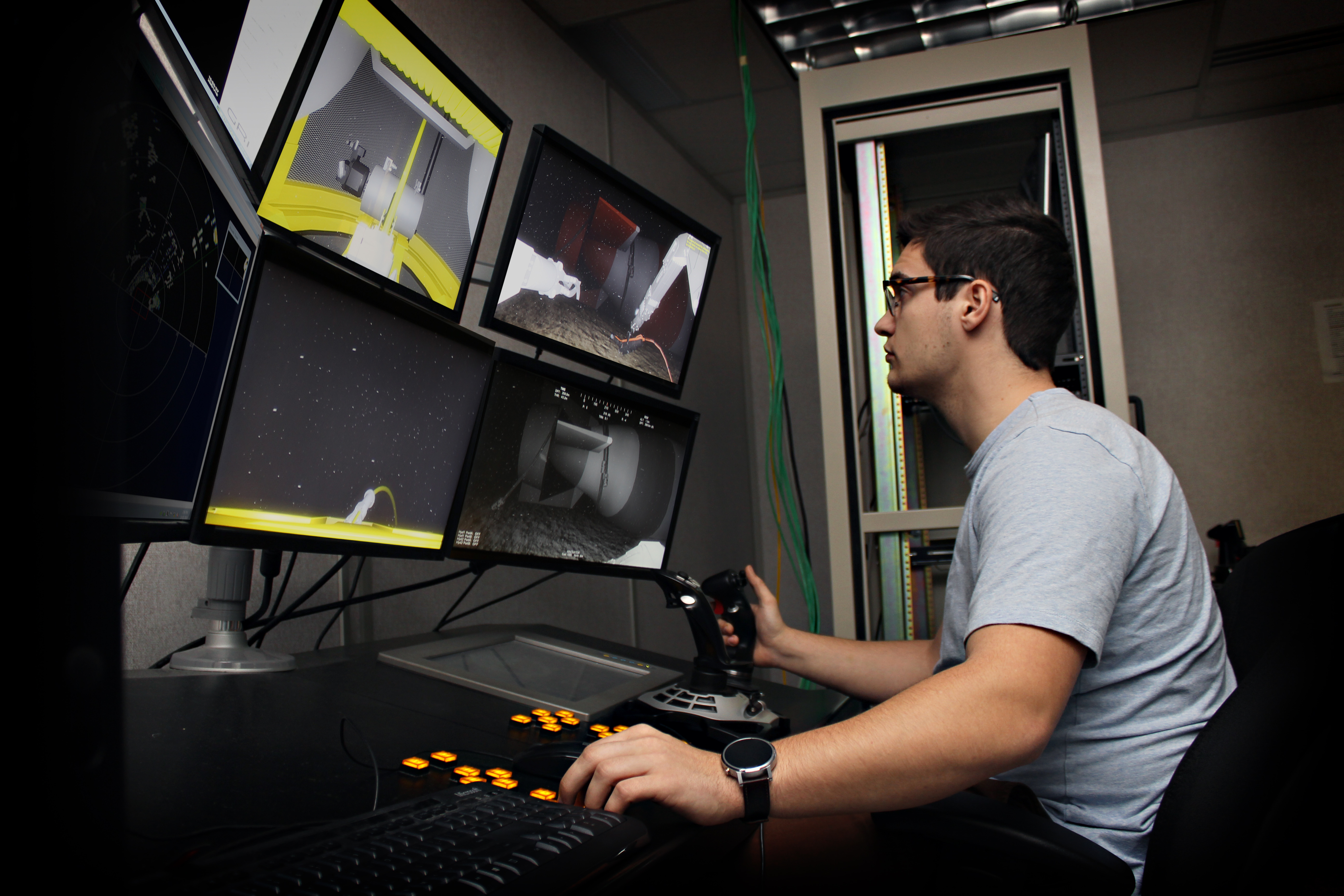 A student at the ROV simulation center at the Marine Institute in St. John's, Newfoundland, trains in a virtual marine environment to operate a work class ROV. (Source: Marine Institute, MUN)