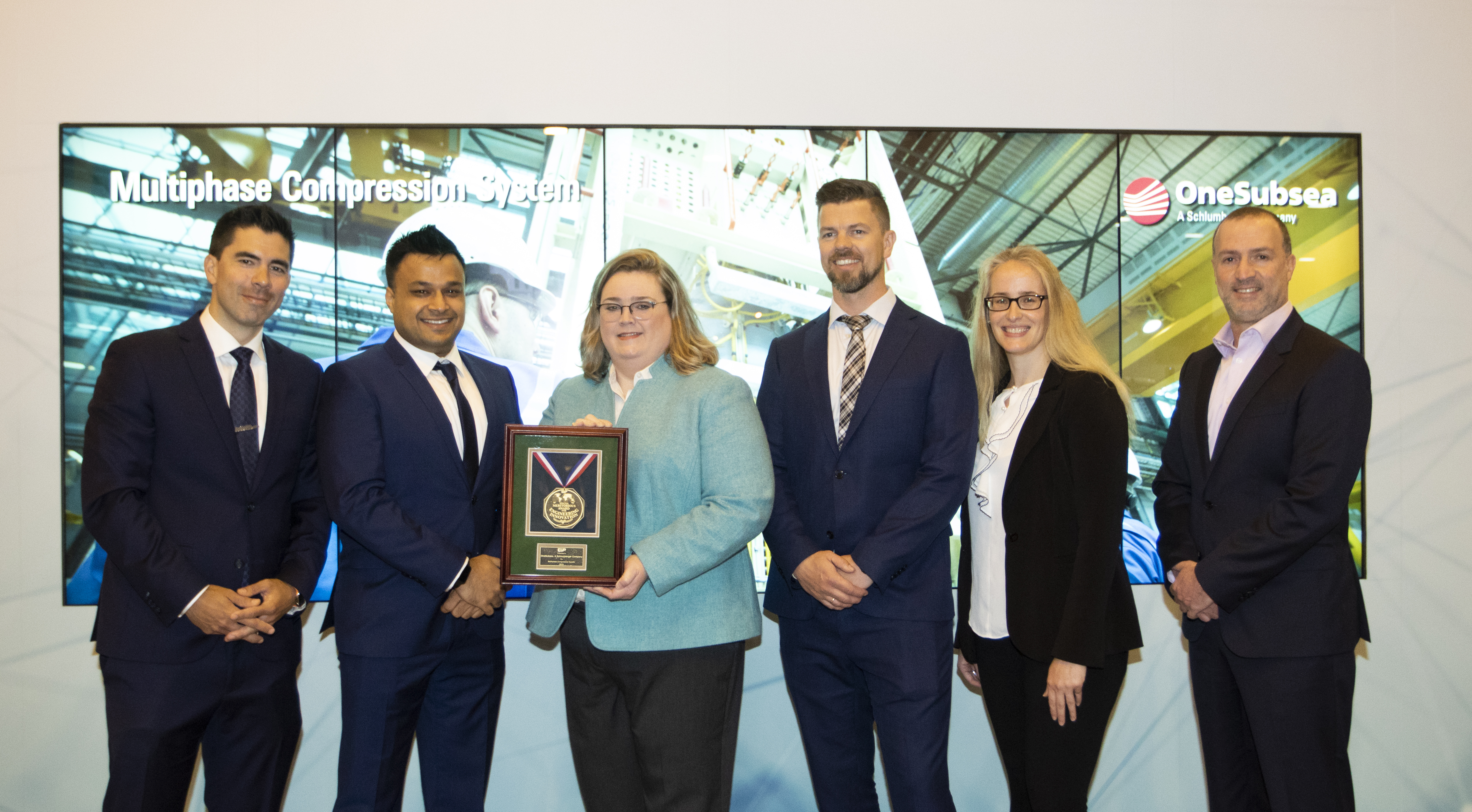 The Multiphase Compression System from OneSubsea, a Schlumberger company, won in the subsea systems category. E&P's Jennifer Presley (third from the left) presented the award to (from left to right) Mads Hjelmeland, Akshay Kalia, Hans Fredrik Kjellnes, Lucile Turpin and Ben Charbit.