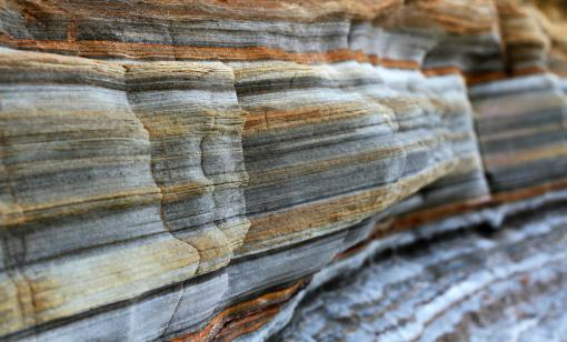 Layers of sedimentary sandstone rock are shown. (Source: SAPhotog/Shutterstock.com)