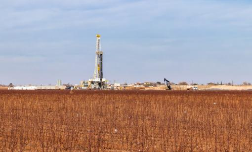 A drilling rig is shown in the Permian Basin in Texas. (Source: GB Hart/Shutterstock.com)