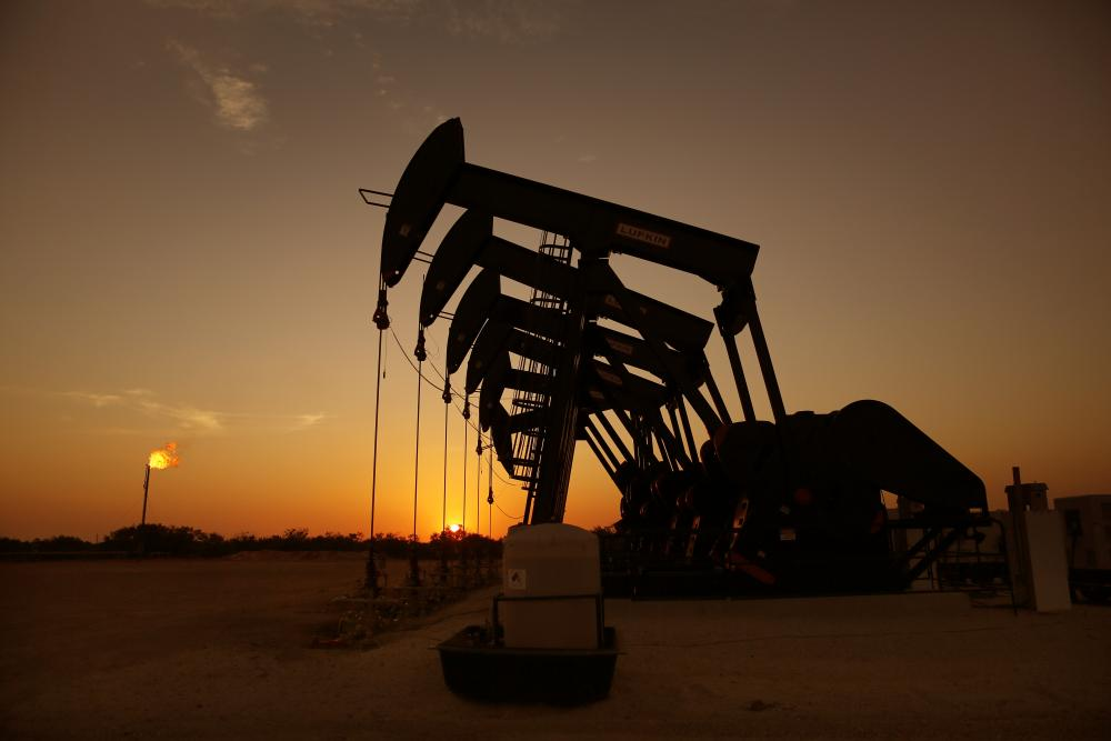 The sun sets behind six pumpjacks producing on a wellpad outside Cotulla, Texas. (Photo by Tom Fox, courtesy of Oil and Gas Investor)