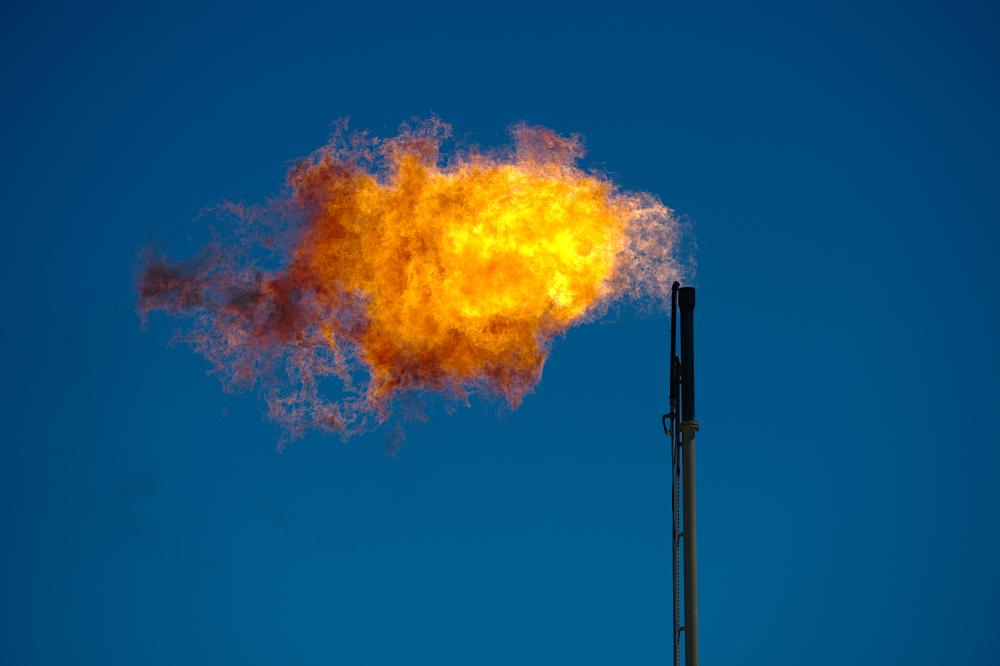 Excess natural gas is burned off at an oil well site. (Source: Sean Hannon/acritelyphoto/Shutterstock.com)