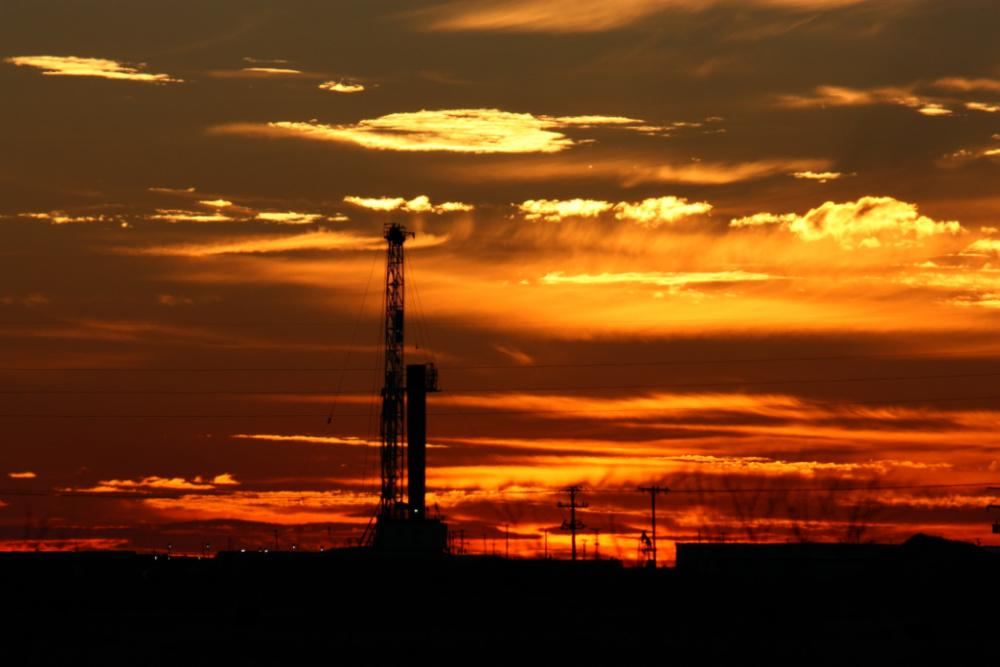 A Permian Basin rig is shown at sunset. (Source: GB Hart/Shutterstock.com)